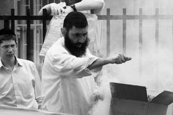 Voodoo beliefs become a factor in public life. Public burning of bread, Passover eve. (Photo: Yossi Gurvitz)