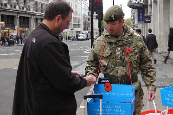 Soldiers distribute poppies in London, Novemeber 2011. (Photo: Yossi Gurvitz)