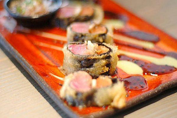 Sushi tray in Israel (Flickr/cc: EyalNow)