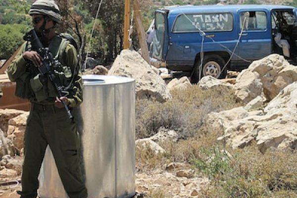 """IDF protecting Hilltop 18 [""""Mitzpeh Avichai"""" written on van] (Photo: Mairav Zonszein)"""