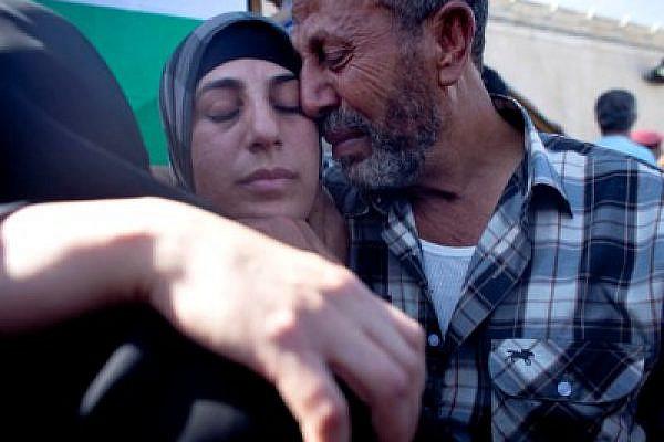 Hana Shalabi and her father reunited in her last release, October 2011 (Oren Ziv / Activestills)