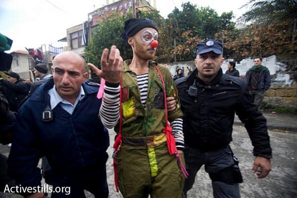 Arrests of activists during a protest in Sheikh Jarrah, December 18, 2009 (photo: Oren Ziv/ Activestills.org)