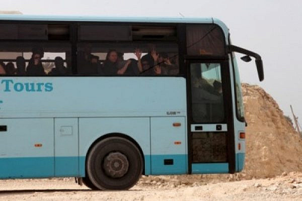 Harvard students on the bus in Al-Walaja (Anne Paq / Activestills)