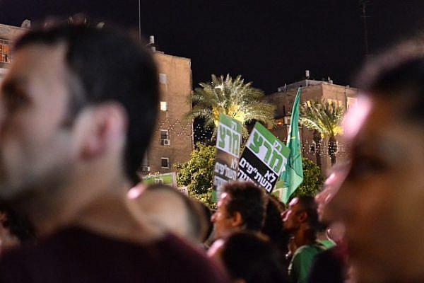 Meretz signs at Occupy Israel social protest, Tel Aviv, 12 May, 2012 (Photo: Dahlia Scheindlin)