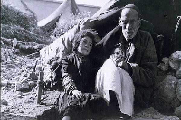 A Palestinian oldman and girl living in a refguee camp after 48 (photo:flickr/gnuckx)