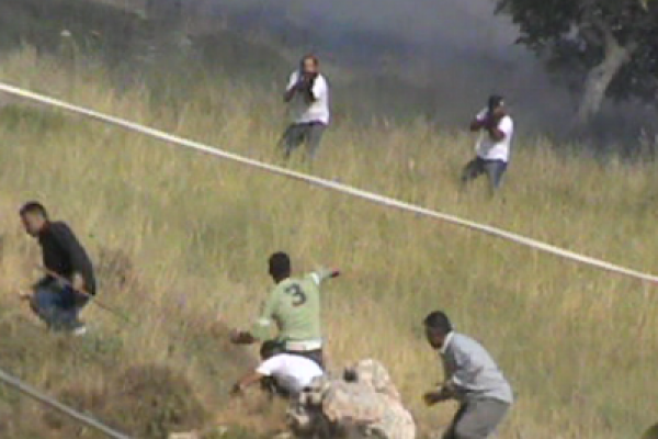 Two settlers from Itzhar shooting at Palestinians (from B'Tselem video)