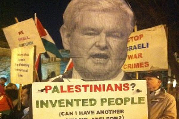 """Protest sign outside 2012 AIPAC conference shows Gingrich asking, """"Palestinians? Invented people (Can I have another $5M Mr. Adelson?)"""", Washington DC (photo: Roee Ruttenberg)"""