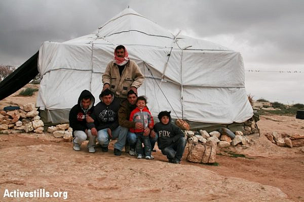 A Palestinian family outside their tent home in the south Hebron Hills village of Susya (Photo: Activestills.org)