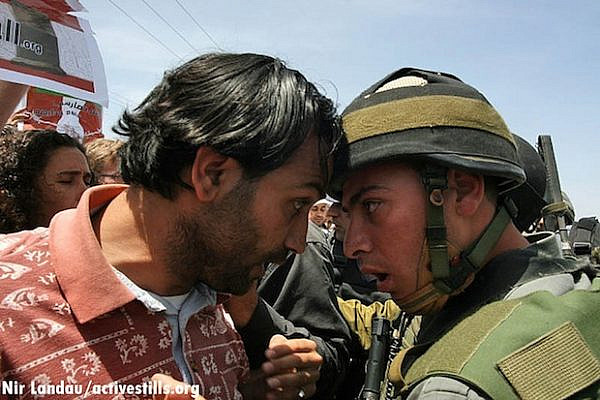Confrontation between Palestinian and IDF soldier in Gush Etzion, 2007 (Activestills)