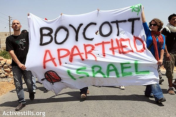 Boycott Apartheid Israel sign at protest in al Ma'asara (activestills)