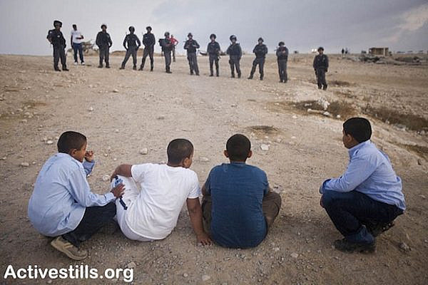 Demolition of Al Arakib as children watch (Activestills)