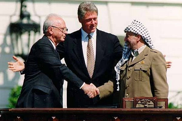 Israeli Prime Minister Yitzhak Rabin, U.S. president Bill Clinton, and PLO Chairman Yasser Arafat at the signing of the Oslo Accords at the White House on September 13, 1993. (Vince Musi/The White House)