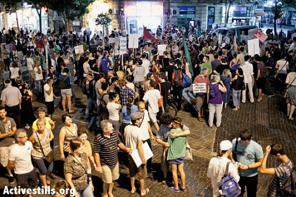 A protest against the attack by a Jewish mob on Three Palestinians in Zion Sq., Jerusalem. August 18, 2012 (photo: Activestills)