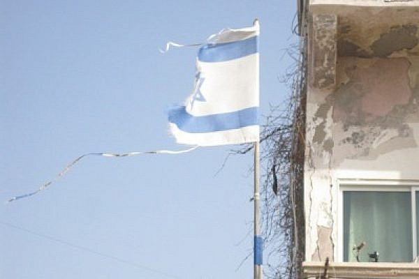 Tattered flag in Jaffa (Photo: Mairav Zonszein)