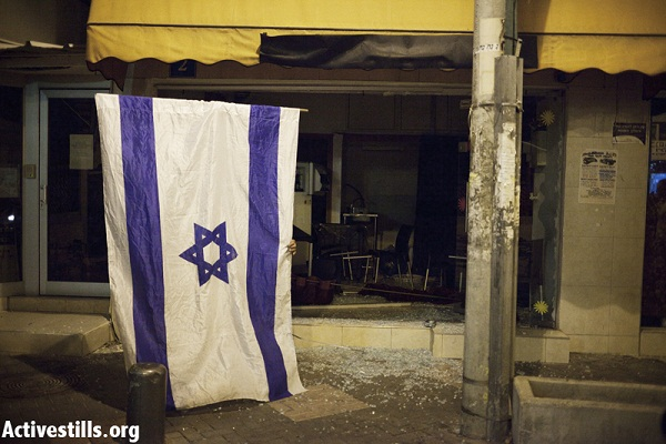 An Ethiopian bar attacked by a mob after a protest against African refugees and asylum seekers in Tel Aviv's Hatikva neighborhood on May 23, 2012. (Photo: Activestills)