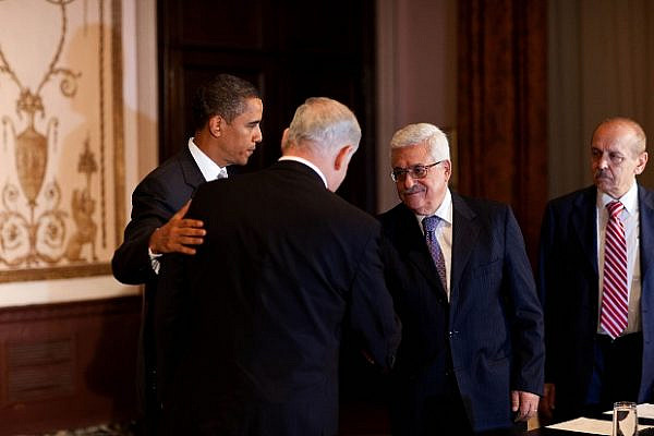 President Barack Obama watches as Israeli Prime Minister Benjamin Netanyahu (left) and Palestinian President Mahmoud Abbas (right) shake hands at a trilateral meeting at the Waldorf-Astoria Hotel in New York, N.Y, Sept. 22, 2009. (Official White House photo by Pete Souza)