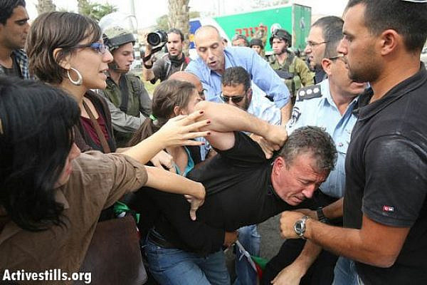 Bassem Tamimi being arrested in the Shaar Binyamin settlement today (photo: flickr/Activestills)