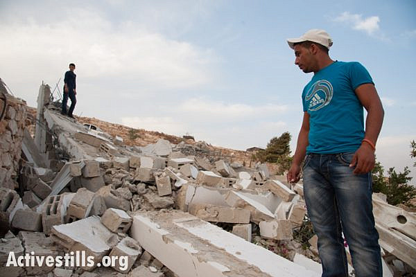 Neighbor Jabril Jahalin, who in July of this year helped to rebuild Beit Arabiya, the family house of Salim and Arabiya Shawamre, surveys the rubble after it was demolished for the sixth time on November 1, 2012. (photo: Ryan Rodrick Beiler/Activestills.org)