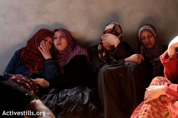 Palestinian women mourning the death of Mahmoud Raed Saddllah, a 4-year-old child, killed in an explosion in Jabaliya, Gaza strip, November 16, 2012. (photo: Anne Paq/Activestills.org)