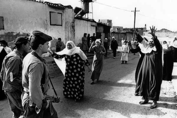 Palestinian women at the Jabaliya refugee camp in the Gaza Strip confront Israeli soldiers over the mistreatment and arrest of Palestinian youths. (photo: Robert Croma / CC BY-NC-SA 2.0)