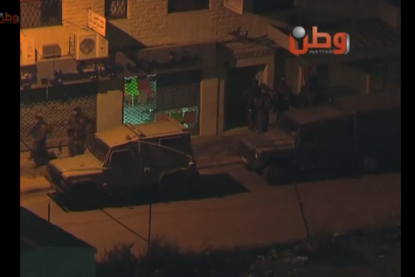 IDF soldiers seen raiding the Union of Palestinian Women's Committee in Ramallah. (screenshot: YouTube)