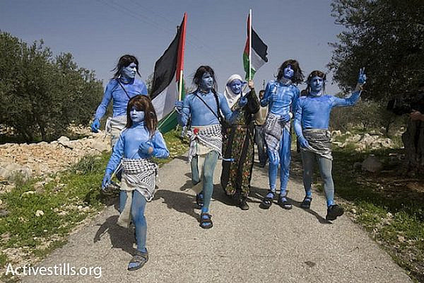 "Anti-occupation activists dress up as characters from the film ""Avatar"" during a demonstration against the separation wall in Bil'in. (photo: Oren Ziv/Activestills)"