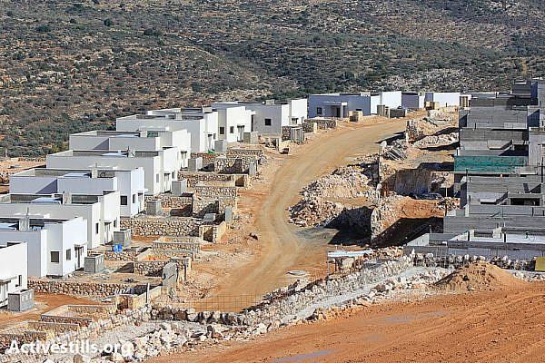 Building of the new settlement of Leshim on the lands of the West Bank village of Kafr ad Dik, near Salfit, December 7, 2012. (photo: Activestills)