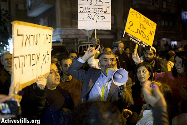 Knesset member MK Micheal Ben Ari shouting slogans during an anti-immigrant demonstration, organized by members of his political party as part of their election campaign, in South Tel Aviv on December 31, 2012. (Photo by: Oren Ziv/ Activestills.org)
