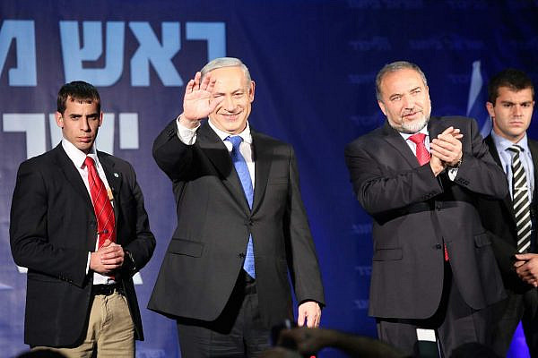 Binyamin Netanyahu and Avigdor Lieberman thank their supporters at the Likud-Israel Beitenu headquarter, January 23 2013 (photo: Yotam Ronen / Activestills)