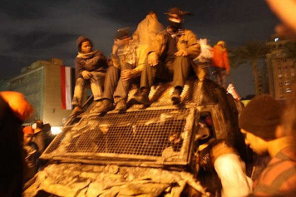 Black Bloc and Tahrir youth celebrate atop a commandeered police truck in the center of the square. (photo: Jesse Rosenfeld)