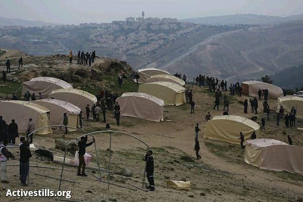 "A Palestinian tent city being constructed by the Popular Committees in the E1 area, January 11, 2013. The camp holds approximately 25 tents, and is called by the activists ""Bab al-Shams"" village. (photo: Oren Ziv/Activestills)"