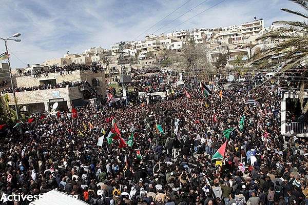 Thousands congregate at the center of  Sa'ir village for the funeral of Arafat Jaradat.