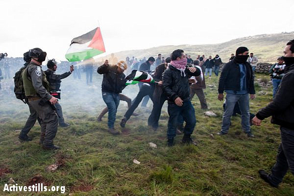 Israeli soldiers use sound bombs and pepper spray to disperse Palestinian activists from a newly created village named Al Manatir on land belonging to the West Bank village of Burin, February 2, 2013. (Photo by: Ryan Rodrick Beiler/Activestills.org)