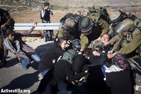 IDF soldiers clash with demonstrators in Nabi Saleh, December 11, 2011 (Oren Ziv/Activestills.org)
