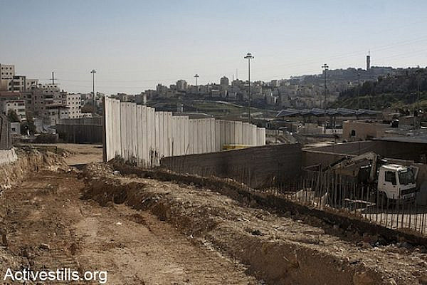Construction of the separation wall in the Shuafat refugee camp, East Jerusalem, January 19, 2013. (photo: Keren Manor/Activestills)
