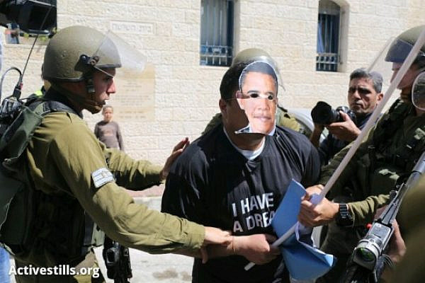 Non-violent Palestinian activist with Obama mask arrested in Hebron (Oren Ziv / Activestills)