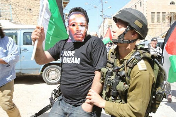 Hebron demonstrators were calling upon Obama to remember the civil rights movement in the US (Oren Ziv / Activestills)