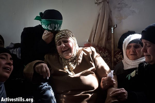 The bereaved mother and sister of Muhammad Asfour cry at his funeral in the West Bank village of Abud, March 8, 2013. Muhammad Asfour, 22, was hit in the head by a rubber coated steel bullet, shot by an Israeli soldier on February 22, 2013 during clashes at the entrance to his home village of Abud, northwest of Ramallah, during a solidarity protest for hunger striking Palestinian prisoners held in Israeli prisons. 