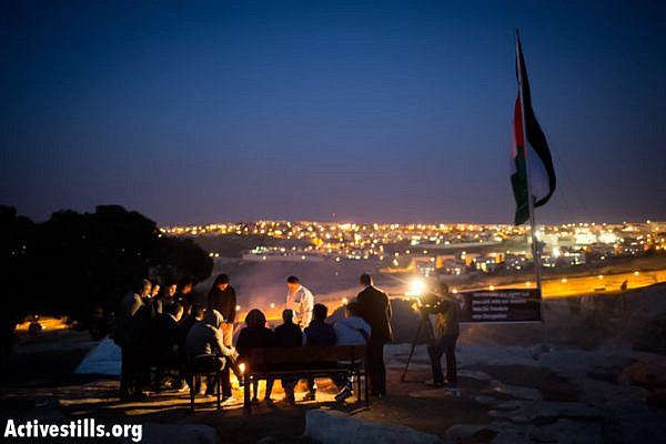 Palestinian activists sit in the new protest camp in the E1 area, West Bank, March 20, 2013. (Photo by: Oren Ziv/Activestills.org)