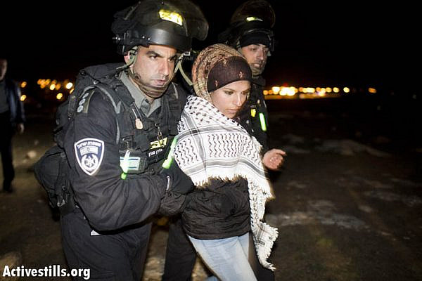 Israeli forces arrest an activist as the camp is forcibly evicted.