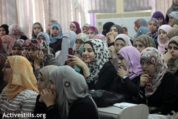 Palestinian women at a writing and art festival in Gaza, May 6, 2012, (Anne Paq/Activestills.org)