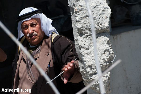 An elder of the Jaradat family stands in the remains of his home demolished by Israeli authorities. (photo: Ryan Rodrick Beiler/Activestills.org)