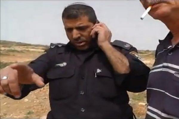 Policeman detaining Ta'ayush activists Screenshot