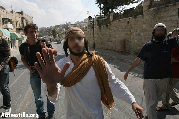 Jewish settlers in Hebron [illustrative photo] (Yotam Ronen/Activestills.org)