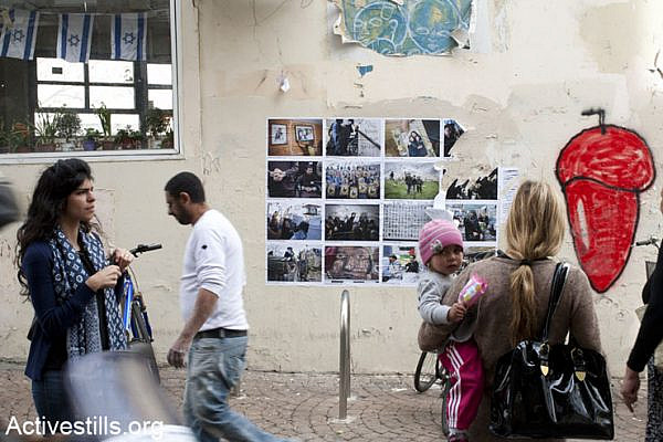 Activists put up a street photo exhibition in solidarity with the Palestinian prisoners in various locations in Tel Aviv, April 17, 2013.