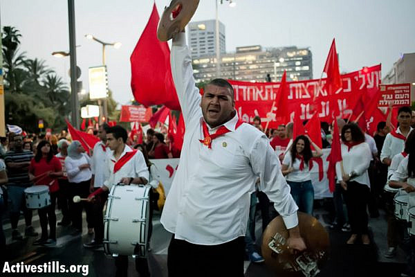 Demonstrators march during the International Worker's Day protest in the center of Tel Aviv May 1, 2013. (Photo by: Shiraz Grinbaum/ Activestills.org)