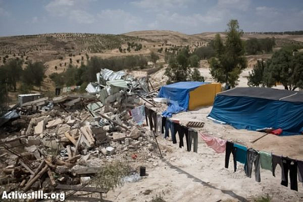 "The ""unrecognized"" Bedouin village of Atir, May 21, 2013. On May 16, hundreds of Israeli policemen surrounded the village completely and demolished 15 structures. Residents of the village have built temporary tents to replace their demolished homes. (Photo by: Oren Ziv/Activestills.org)"