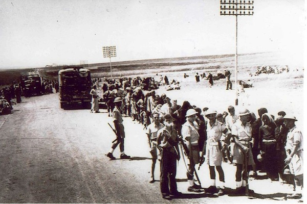 Palmach troops overseeing the displacement of Palestinians from the central city of Ramlah in July, 1948. (Photo: Palmach Archive)