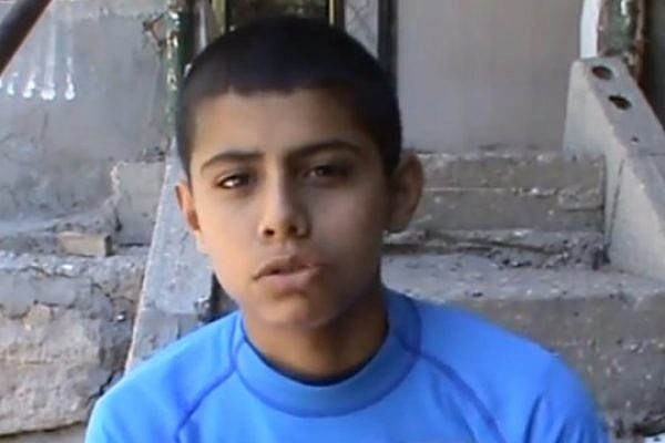 14 years old Muhammad Ayman Awawdeh is prevented from visiting his father, who is held in Israeli prison (photo: B'tzelem)