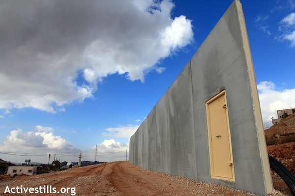 A partly constructed portion of Israel's separation wall, in Walaja, December 7, 2010 (Anne Paq/Activestills.org)